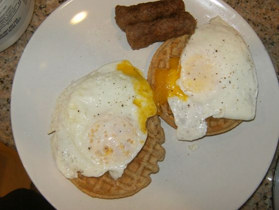 fried eggs, waffles, sausage links