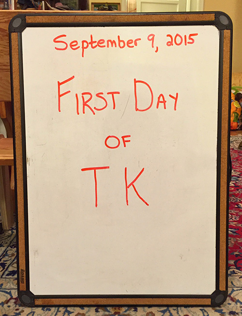 "whiteboard with date and ""First Day of TK"" written on it"