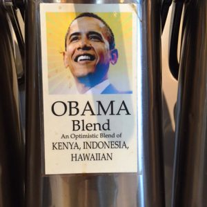 "label on coffee dispenser reading ""Obama Blend: an optimistic blend of Kenya, Indonesia, Hawaiian"""