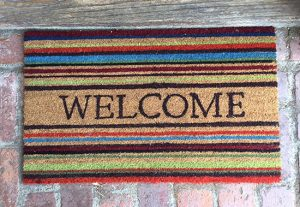 "picture of coir mat with horizontal stripes and word ""Welcome"" in center"