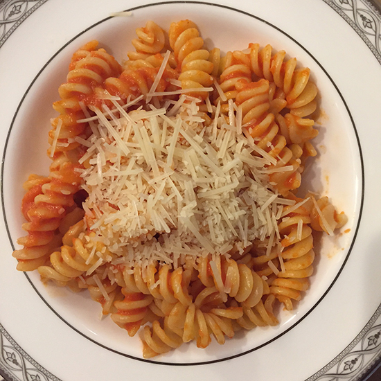 Bowl of rotini with Marcella Hazan's tomato sauce and parmesan