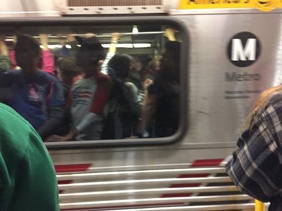 Blurry motion picture of full Metro Red Line car carrying 2017 Women's March participants to downtown L.A.